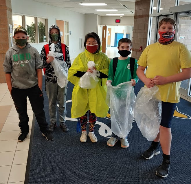 Pictured left to right above are Casey, Lucas, Crookston Kiwanis member Rae French, Kahnen, and Lennon.