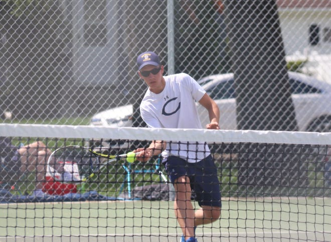 Mason Owens during Crookston's 4-3 win over Benson on Monday in the Section 8A team tournament. Owens, along with his playing partner Jack Garmen, won one match and lost another in the Section 8A doubles tournament Tuesday.