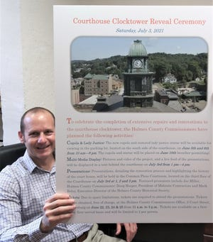 Mark Leininger displays the Courthouse Clocktower Reveal Ceremony poster, promoting the July 3 event to show off the finished reconstruction of the clocktower.