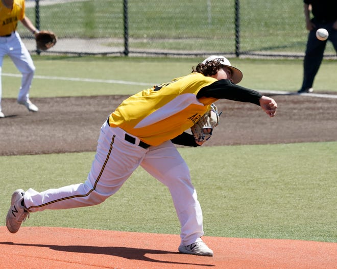 Adrian College's Gage Ricker delivers a pitch during an MIAA tournament game against Kalamazoo.