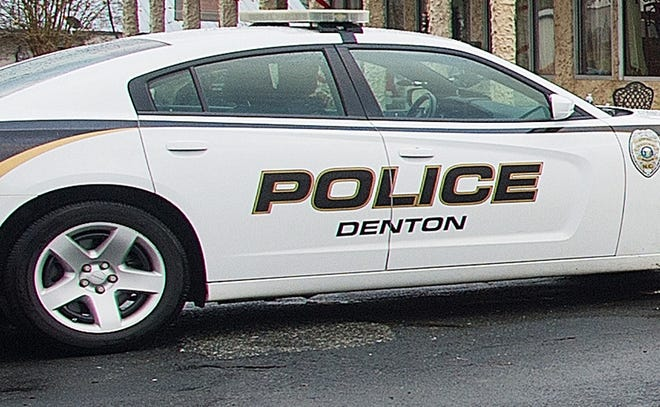 Two Denton Police officers were struck by another vehicle Monday afternoon while sitting in their patrol car on Business 85 writing a traffic citation.