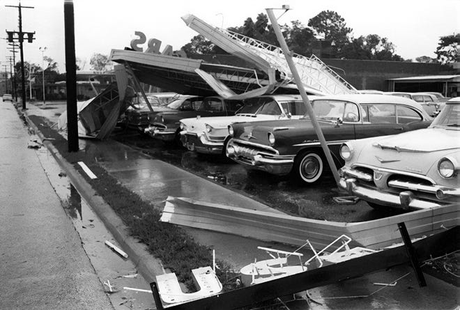 """A Volusia Avenue car lot damage during Hurricane Donna in 1960. """"Steel signs twisted the like pretzels"""" The Daytona Beach Morning Journal reported."""