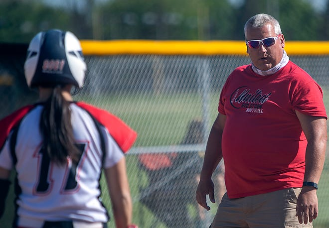United High School softball coach Marc McMahon gives instructions to Alyssa Beltran between cuts in an 8-4 Red Storm victory over the Silver Streaks of Galesburg at GHS on Friday, May 7, 2021.