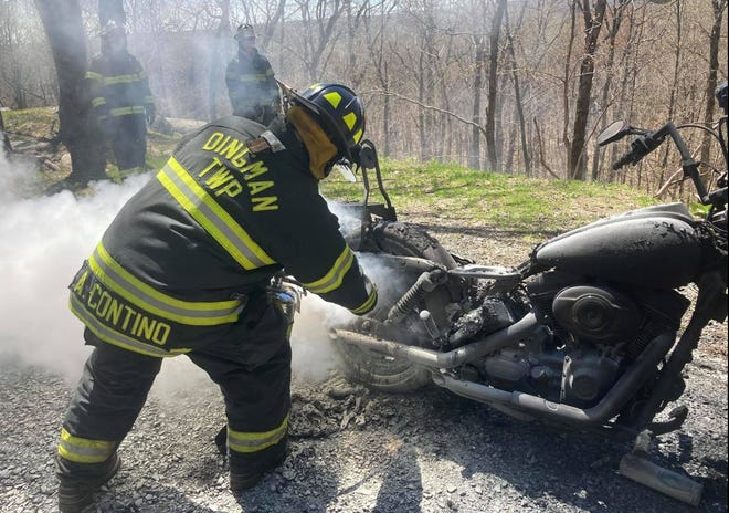 Dingman Township Volunteer Fire Department volunteers extinguish a motorcycle fire, May 1st. (Station 26 photo)