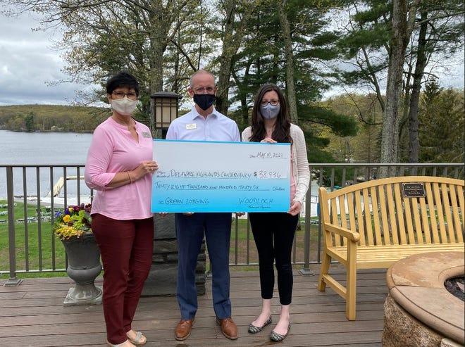 From left, Tess Murray and Bob Kiesendahl, Woodloch Resort, with Bethany Zarnowski, Delaware Highlands Conservancy. Location: Woodloch Resort. (Contributed photo)