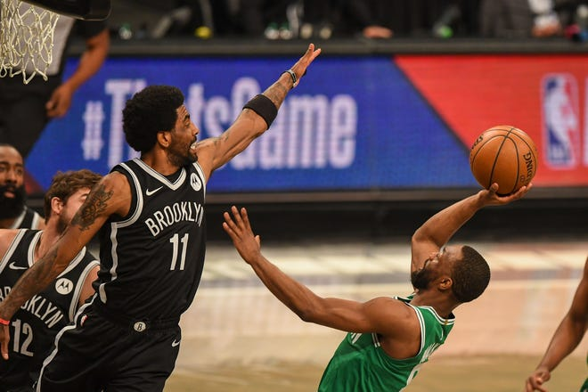 May 22, 2021; Brooklyn, New York, USA;  Boston Celtics guard Kemba Walker (8) shoots defended by Brooklyn Nets guard Kyrie Irving (11) during the first quarter of game one in the first round of the 2021 NBA Playoffs. at Barclays Center.
