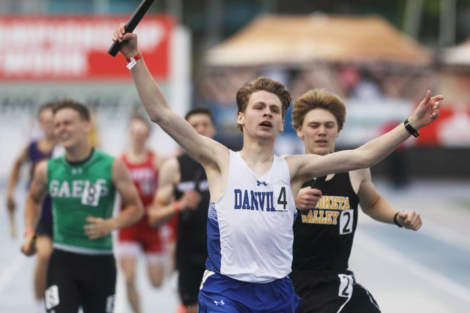 Danville's Ty Carr crosses the finish line to win the  Class 1A boys 4x400 meter relay final during the final day of the 2021 Iowa High School Track and Field Championships Saturday May 22, 2021, at Drake Stadium in Des Moines.