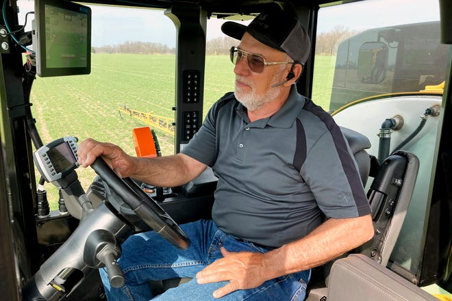 Farmer Rick Clifton drives a spray tractor across one of his fields, applying herbicide to cover crops that occupied the ground during fall and winter in Orient, Ohio, on April 5. Clifton grows cereal rye and rapeseed to prevent erosion and make the ground healthier for his corn, soybean and wheat cash crops. Cover crops store carbon in the soil, keeping the greenhouse gas out of the atmosphere.