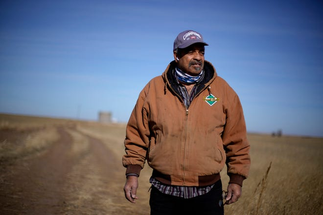 In this Jan. 13 file photo, Rod Bradshaw stands in a field of wheat on his farm near Jetmore, Kan.