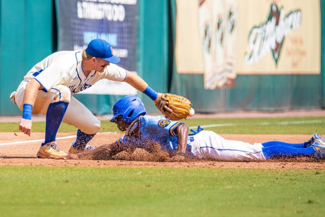 Orlando First Academy's Khadin Bastian tries to slide in around the tag of Bolles third baseman Tanner Zellem during Monday's FHSAA Class 3A baseball semifinal.
