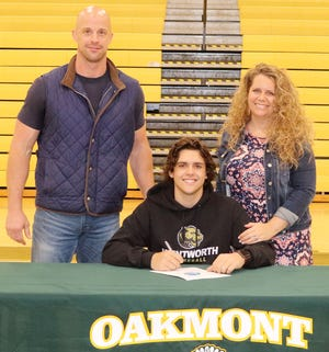 Oakmont senior Brady Aubuchon, pictured with his parents Scott and Kirsten Aubuchon, will continue his education and athletic career at the Wentworth Institute of Technology next fall.