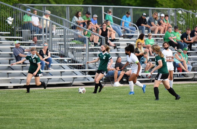 Taylor Minnaert, left, Chloe Adams and Hannah Vondra in action in the Geneseo-Sterling match which was Senior Night for the Geneseo team.