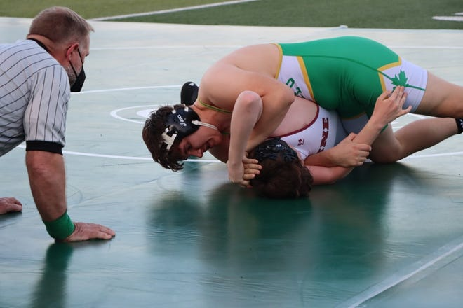Geneseo's Tim Stohl, sophomore, wrestled at the 220 pound weight class to turn his opponent, Garrett Meyers, Moline, to earn back points on his way to a win by pin.