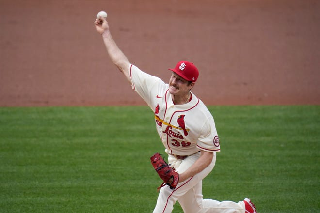 St. Louis Cardinals starting pitcher Miles Mikolas throws during the first inning of Saturday's game against the Chicago Cubs, in St. Louis.