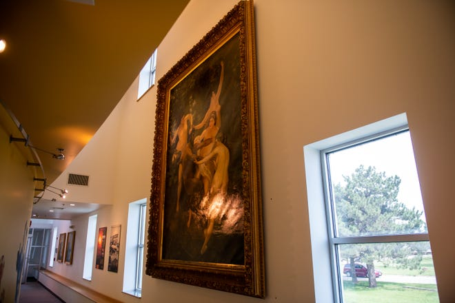 """A forgery of William-Adolphe Bouguereau's """"Nymphs and Satyr,"""" bought by Peoria's Pete Weast in 1890, hangs in the WTVP offices on Monday, May 24, 2021."""