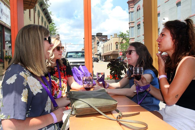 Hannah Maurer, left, Sarah Boyer, Emily Winders, and Sophi Edwards enjoy wine Saturday, May 22, 2021, during Pretzel City Winefest in downtown Freeport.
