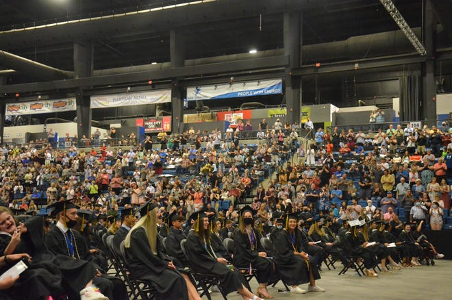 """Members of the Newton High School Class of 2021 receive a standing ovation for """"defeating COVID-19"""" their junior and senior years of high school. Graduation ceremonies were hosted at Hartman Arena in Park City in part to deal with COVID-19 concerns."""