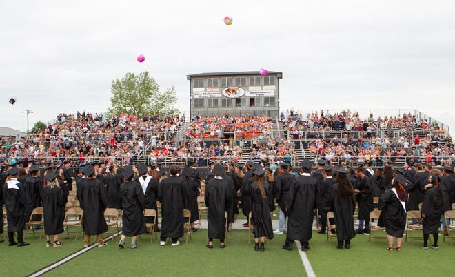 Kirksville's Class of 2021 tosses caps and beach balls into the air at the conclusion of Sunday's graduation ceremony at Spainhower Field.