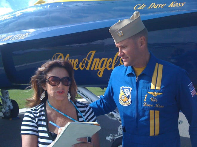 Mary Shawn Toothman interviewing U.S. Navy Cmdr. Dave Koss of the Blue Angels at the annual Sun 'n Fun Fly-In.