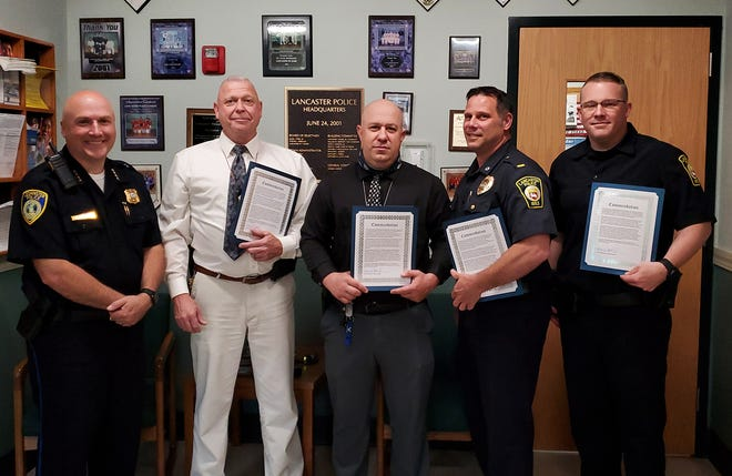 Lancaster Police Chief Edwin Burgwinkel recently joined the Leominster chief in giving letters of commendation to officers involved in the year-long investigation that resulted in the search warrants leading up to the arrest of Lancaster's John Duplease on running an organized retail crime operation. Shown with Leominster Chief Aaron Kennedy (left) are Leominster Detectives Richard Shea and John Bouchard, Lancaster Police Lt. Everett Moody and Lancaster Detective Andrew Shaw.