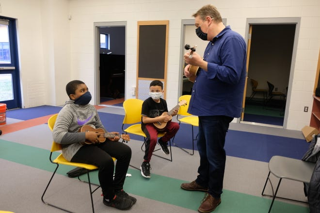 Ukulele teacher Douglas Siqueira helps students at the Boys & Girls Club of Fitchburg and Leominster find the right notes.