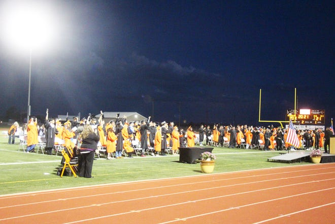 The La Junta High School Class of 2021 celebrates after getting their diplomas Sunday at Tiger Stadium.