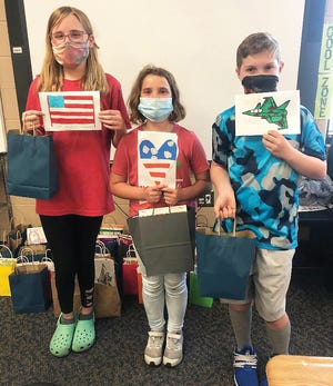 Ella Timmer, Kami Skinner and Caiden Kinnison delivered letters and care packages to military veterans as part of Basehor Intermediate School's Kindness Day on May 14.