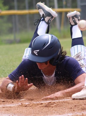 East Fairmont's Clay Hershberger sagely slides into home in the Bees' 7-0 victory over Frankfort.