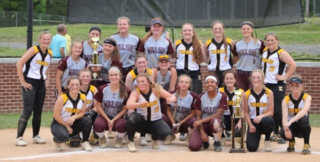 Keyser and Bishop Walsh pose together with their first and second place trophies after the championship game of the Ron Mathias Memorial Tournament. Keyser defeated Bishop Walsh 6-4 in eight innings to claim the top prize.