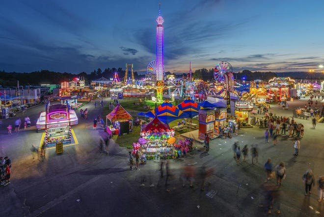 In this Aug. 9, 2018, file photo, fair-goers attend The State Fair of West Virginia at the State Fairgrounds in Fairlea, W.Va. West Virginia has seen a higher percentage of residents depart than any other state in the past decade.