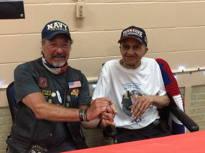 Mike Stramaglio, organizer of the Patriot Pack Ride, greets honoree Clifton Brooks Sr. at the Keyser Moose Lodge. The Patriot Pack rode across the United States over the past week to arrive in Keyser Sunday to honor Mr. Brooks, who served with the famed Tuskegee Airmen during World War II.
