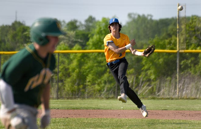 Jefferson shortstop Gavin Gelso comes up throwing on an infield hit, but Joey Godfrey of Flat Rock beat the throw Monday.