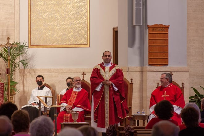 Father Zaid Chabaan celebrated his first Mass as a priest at St. John the Baptist Catholic Church in Monroe Sunday. With him on the altar were Deacon Mike Stewart (left) and Deacon Aaron Poyer, who went to the seminary with Father Zaid.