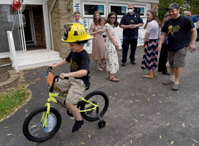 Malachi Doherty, 9, takes his first spin on his new bike, which was a birthday present from the Monroe Township Fire Department. Malachi was diagnosed with Ewing's Sarcoma cancer when he was five-years-old, but he's been cancer free for three years.