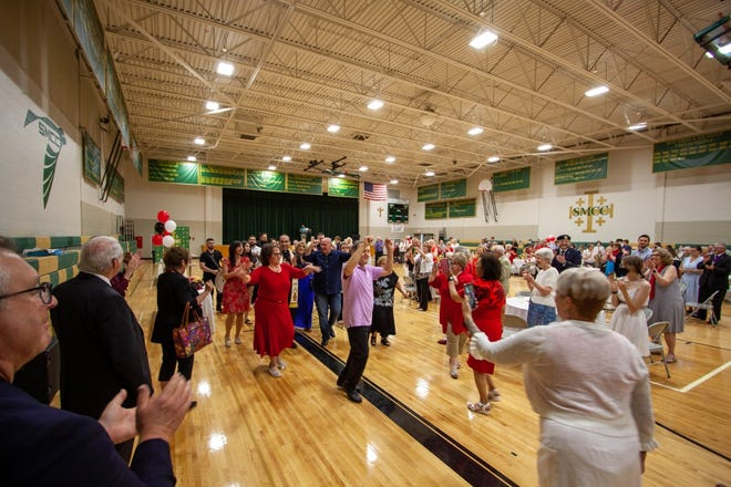 The celebration of the ordination of Father Zaid included much dancing and feasting at St. Mary Catholic Central High School.