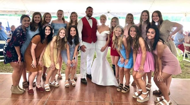 St. Mary Catholic Central girls soccer coach Laura Durance married Erie Mason graduate Brandon Perry Saturday. Among the guests at the wedding were the SMCC varsity soccer players. The Kestrels open the state tournament Thursday.