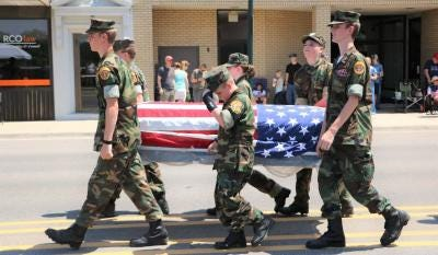 The Young Marines carry a casket representing deceased members of the U.S. Military during the 2018 Memorial Day parade through downtown Monroe. The holiday parade will be held Monday for the first time since 2019.