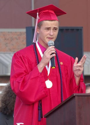Ottawa High School senior Chris Hanson gave a rousing speech to his fellow graduates Saturday during the commencement exercises at Steve Grogran Stadium. His peers gave him a standing ovation.