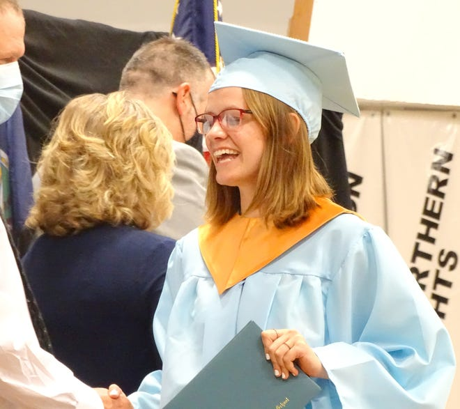 Central Heights senior Cheyanne Kuczmarski smiles big as she receives her high school diploma Saturday during Saturday's commencement ceremony in the high school gym.