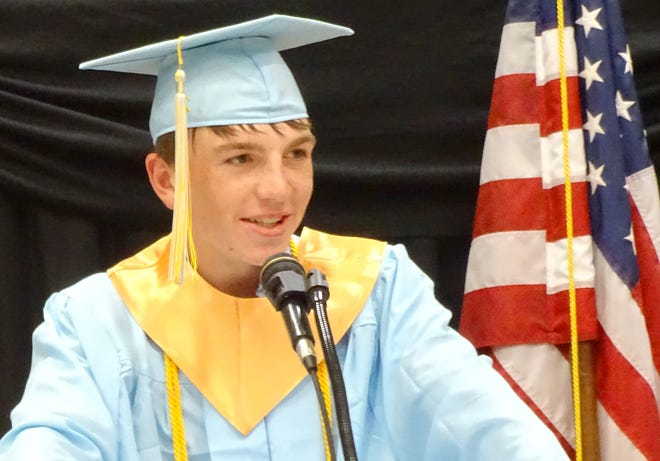 Central Heights senior Cass Burroughs, a valedictorian, gives a speech to his fellow graduates.