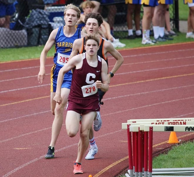 Charlevoix's Sam Peterson runs a group of runners during a distance race Saturday.
