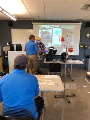 North Central Michigan College paramedic instructor Brendan Keenan teaches an EMS student in a lab setting.  The college has announced expansion of its Emergency Medical Services programs to include regional delivery at locations in both Gaylord and Alpena.