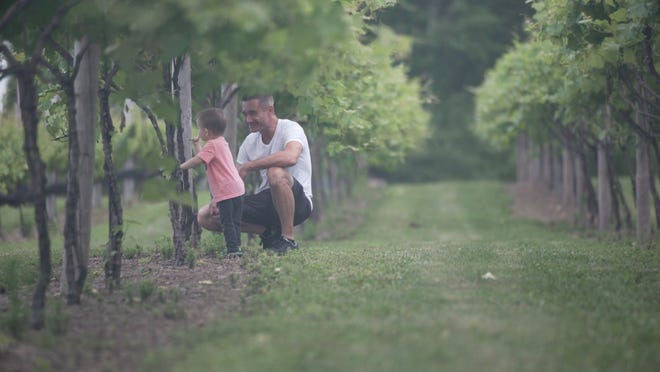 """Randy Detrick and his son check out some of the vines at Blue Ridge Estate Vineyards and Winery as seen in the documentary, """"Blue Ridge: The Randy Detrick story."""""""