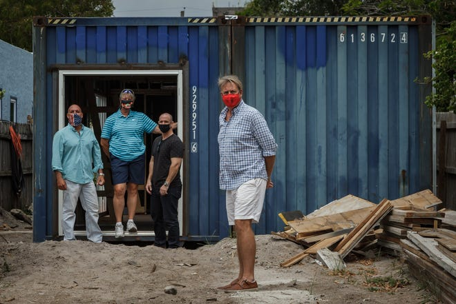 From left, Raul Varas of West Palm Beach; Barb Lilley, Lake Worth Beach; Chris Wise, Wellington; and Roger Bennett, Lake Worth Beach, are shown Tuesday at the construction site of Bennett's shipping container home in Lake Worth Beach. Varas and Wise are the general contractors from Legacy Brothers Construction and Lilley is a local real estate agent.