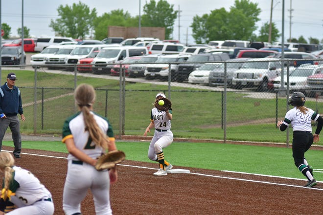Pratt High School softball player Livia Swift (jr) catches a shovel from pitcher Brooklynn Humble to get the out in regional action last week.
