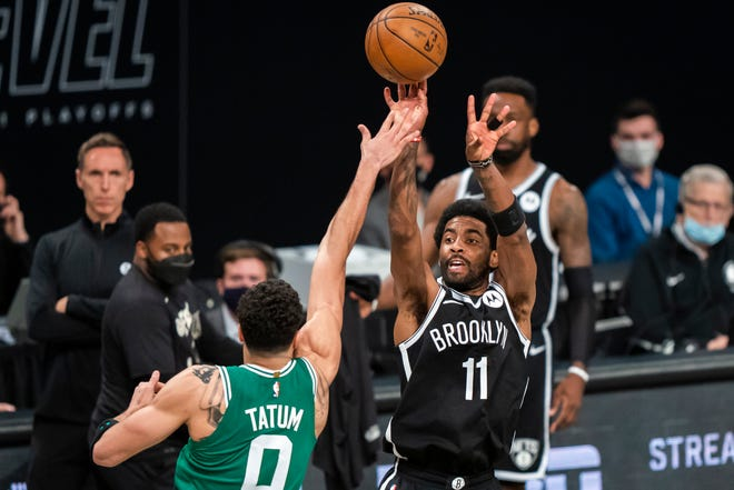 Brooklyn Nets guard Kyrie Irving (11) shoots over Boston Celtics forward Jayson Tatum (0) during the second half of Game 1 of an NBA basketball first-round playoff series Saturday, May 22, 2021, in New York. (AP Photo/Corey Sipkin) ORG XMIT: NYCS116