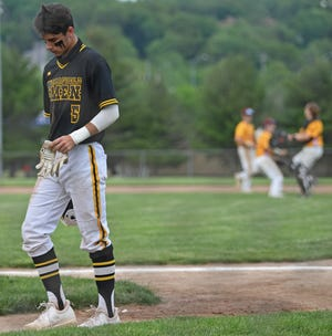 Garfield's Eric Geddes walks off the field after Garfield was defeated by Cardinal Mooney 12-1 in their OHSAA tournament game, Monday night at Cene Park in Struthers.