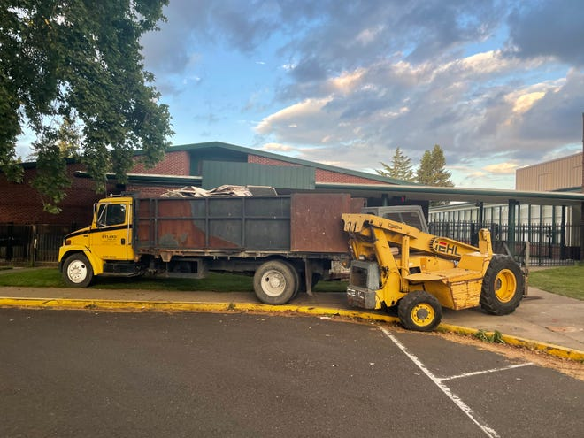 Construction equipment sits outside Kelly Middle School on Friday evening, where a man was killed in an accident at a construction site earlier Friday, May 21, 2021.