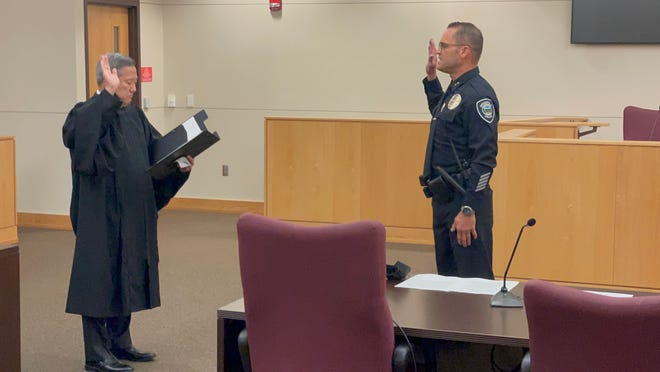 Andrew Shearer, right, is sworn in as the new interim police chief for the city of Springfield on Monday, May 24, 2021.