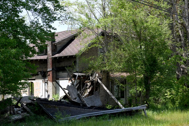 A dilapidated house at 2465 Waynesburg Dr. SE in Canton Township is going through Stark County Land Reutilization program to obtain funding to raze the house.